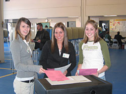 First-time voters, Amber Lettre, Hannah Corey, and Emily Antognioni submit their ballots at the Annual Town Meeting Election on March 7, 2006
