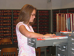 Assistant Town Clerk, Cassandra Barbeau, filing cards in the Land Records index