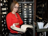 Town Clerk, Cassandra Barbeau, checking on various records in the vault